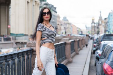 Young trendy woman posing in the street