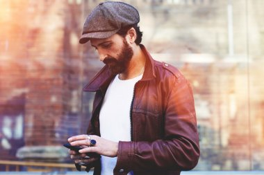 Bearded man using mobile phone