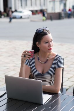 Businesswoman sitting front open laptop