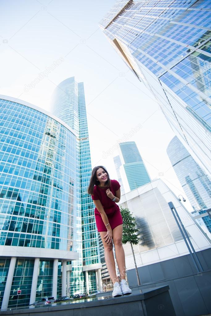 Woman posing near modern office building