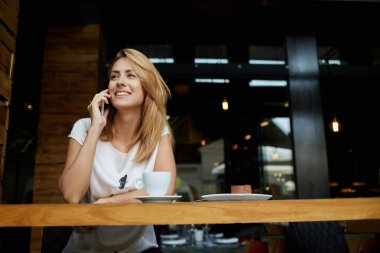Woman having mobile phone conversation
