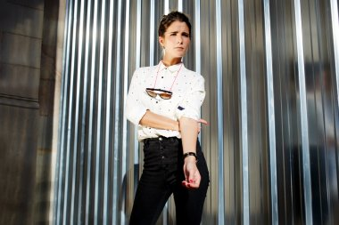 Glamorous female model in trendy clothing