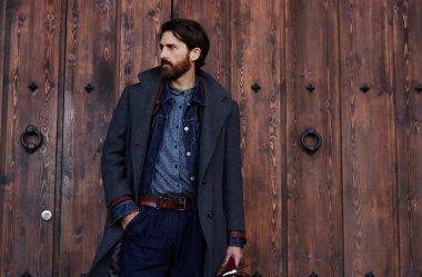Trendy bearded man posing outdoors