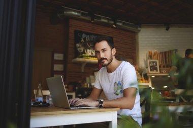man freelancer working on laptop computer