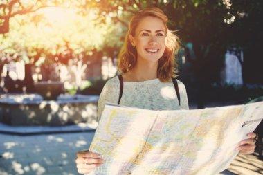 female traveler exploring location map