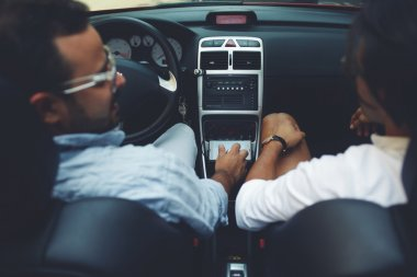 Two men sitting in cabriolet car