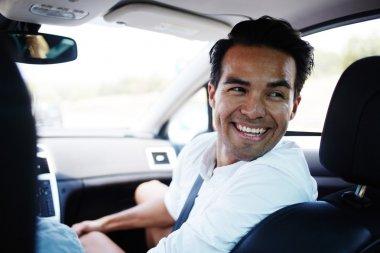Smiling Latin man talking with passengers