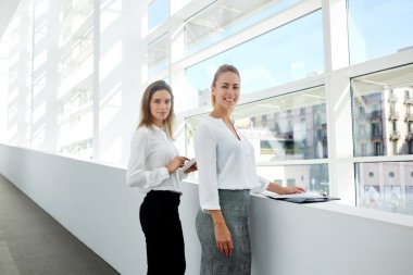 businesswomen with touch pad and folder documents