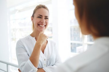 businesswomen having pleasant conversation
