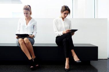 Two women financiers preparing for interview