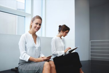 businesswomen with cell telephone and digital tablet