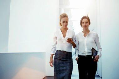 Two businesswomen in modern office interior