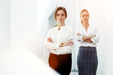 successful women standing in modern office