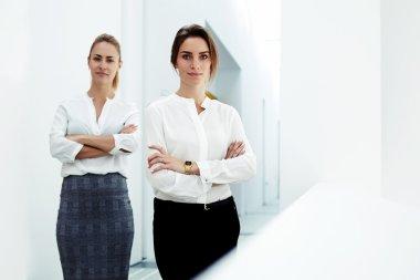 successful women standing in modern office