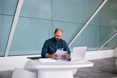 male entrepreneur reading paper report