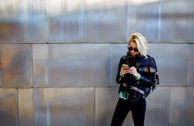 hipster girl chatting on cell telephone