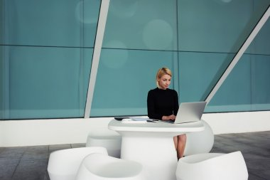 Woman keyboarding on portable net-book