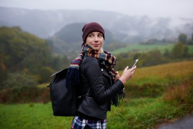Woman with cell telephone in mountains
