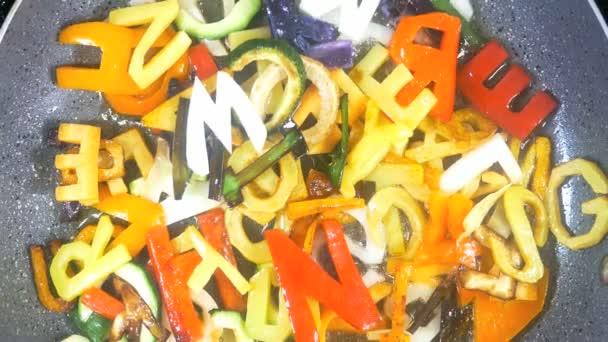 Stir-frying mixed alphabet letters vegetables