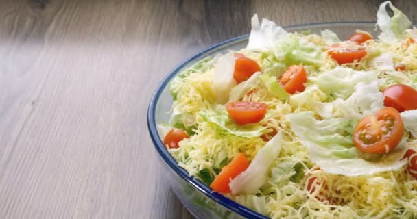 Beautiful colourful caesar salad with dressing croutons and parmesan cheese, healthy meal