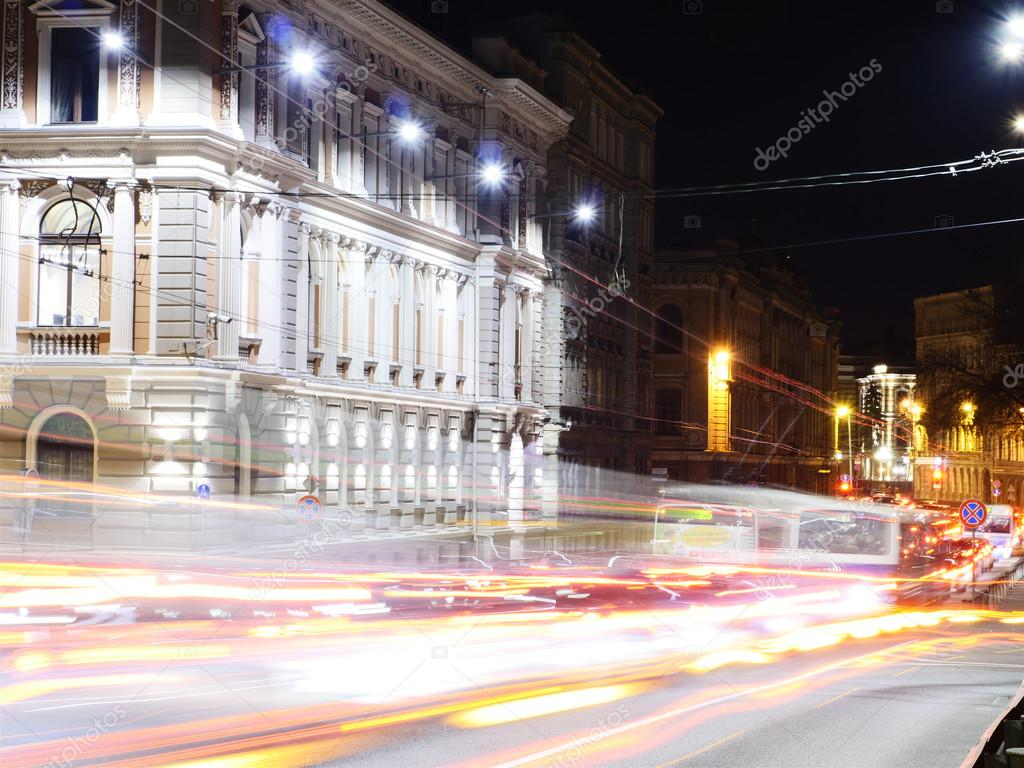 NIght viw of Historic bulding and light trails in european city