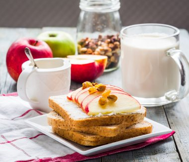 bran toast with cheese, apple and dried fruits, healthy breakfas