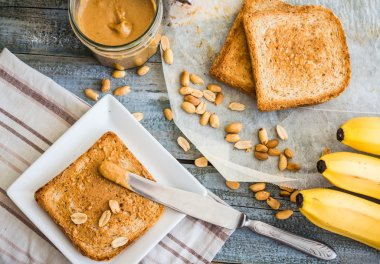 crispy toast with peanut butter, bananas, breakfast, top view