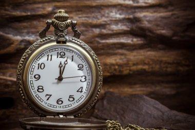 Retro pocket watch ancient on wood