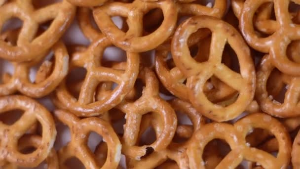 Close up of salted savory mini pretzels in the traditional looped knot shape. Top view. Rotation video