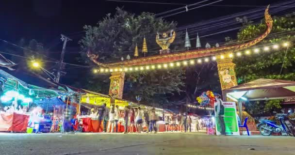 Timelapse of entrance gate to night market festival there sign of procedure to prevent COVID-19 in front, Nan, Thailand: October 2020