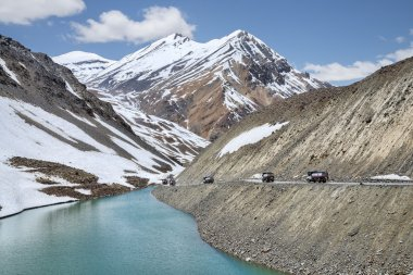 Pack of oil trucks in mountains