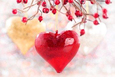 Three hearts hanging on tree
