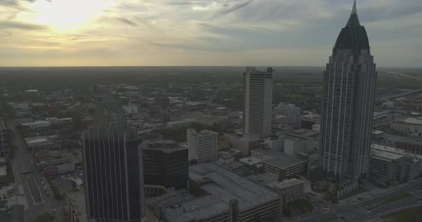 Mobile Alabama Aerial v3 Flying over downtown area at sunset into birdseye view - March 2020