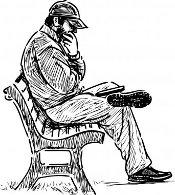 man reading on a park bench.