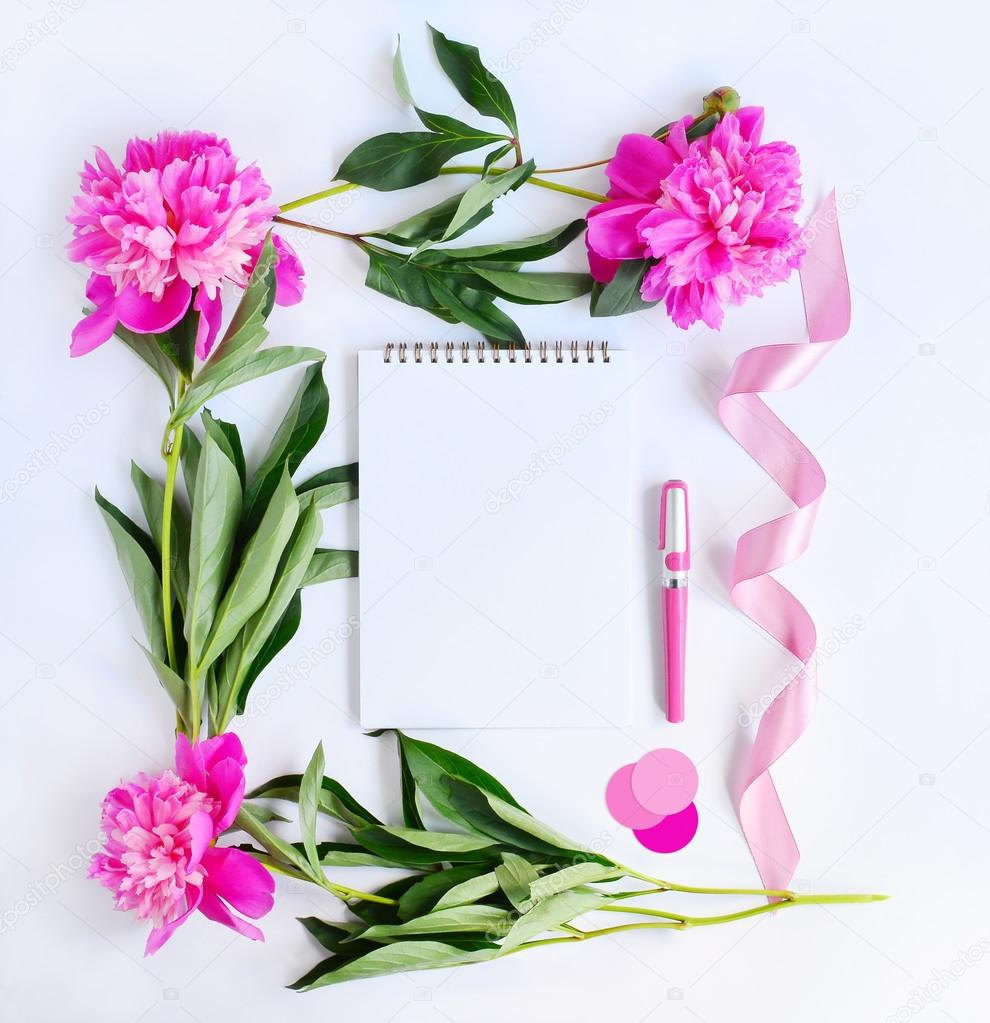 Album and pink flowers