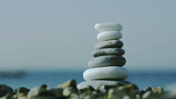Close Up of pebbles stack on sea background