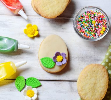 Cookies with decorations tools, icing, marzipan flower, nonpareil