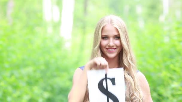Znak dolaru v rukou krásná mladá dívka