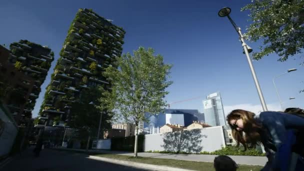 Time lapse of a tree under the buildings Bosco Verticale or Vertical Forest in Milan, Porta Nuova district, 4k.