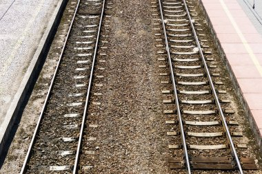 Railway top view background. Train transport industry. Rail tracks texture. Old railroad wooden tie. Track ballast gravel made of crushed stone.