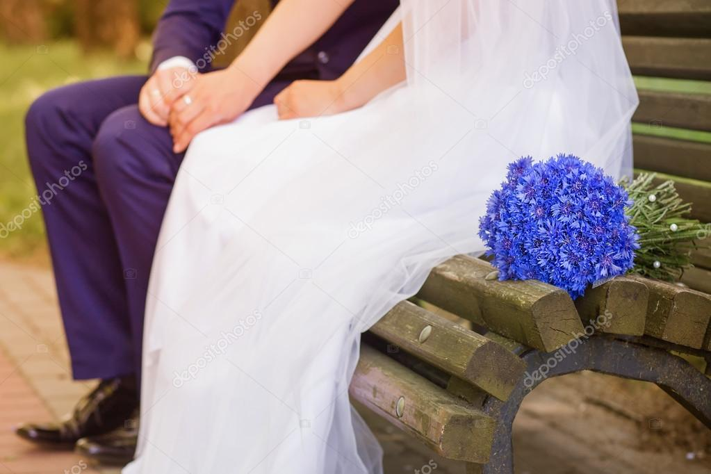 Bride and groom sitting on a bench