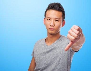 Asian man doing negative gesture