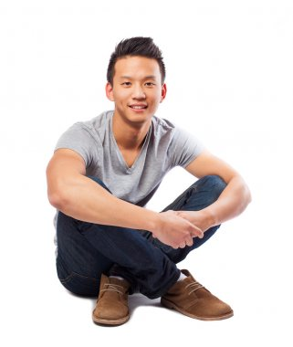 Asian man posing sitting