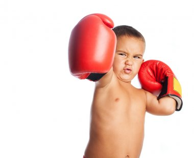 Little boy wearing boxer gloves