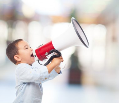 Little boy shouting with megaphone