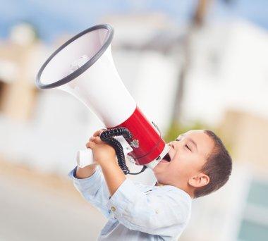 Little boy shouting on megaphone
