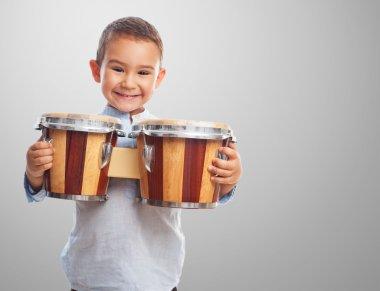 Little boy holding drum