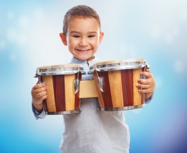Little boy holding drum
