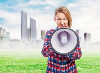 Pretty woman shouting with megaphone