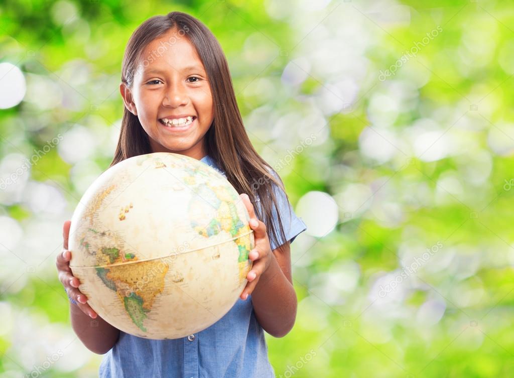 Cute girl holding world globe
